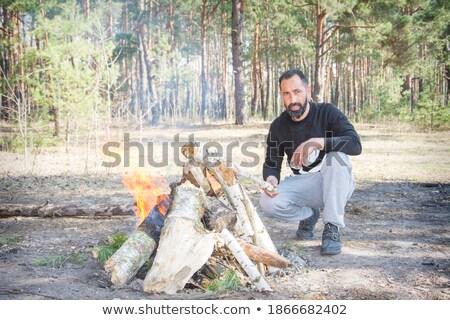 Jóképű férfi máglya portré erdő fa fa Stock fotó © deandrobot