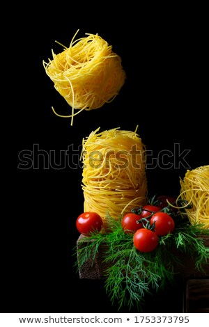 Stock photo: Egg in Nest on Wooden Table against Black Background
