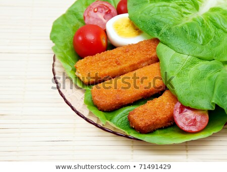 Fish sticks with egg salad on a platter. Stock photo © g215