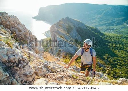 Escalada gancho equipamento topo céu esportes Foto stock © zurijeta