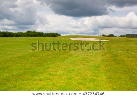 Sand golf bunker on a empty golf course before rain Stock photo © CaptureLight