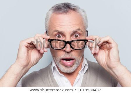 портрет глядя зрелый человек изолированный черный лице Сток-фото © meinzahn