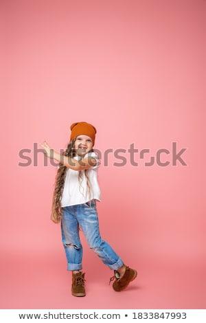 şık küçük kız yırtılmış kot ayakta poz Stok fotoğraf © deandrobot