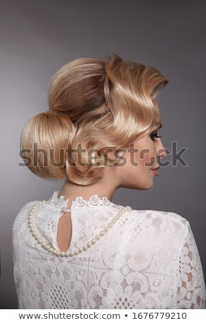 Beuatiful blonde with a fabulous coiffure Stock photo © konradbak
