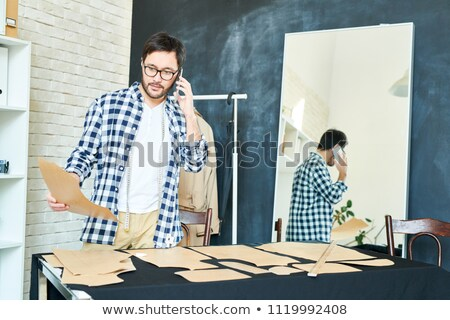 Busy tailor working in parlour Stock photo © dash