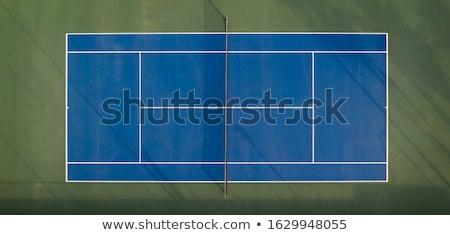 Widok z lotu ptaka kort tenisowy poznania ludzi grać tenis tle Zdjęcia stock © vlad_star