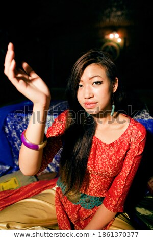 young pretty asian girl in bright colored interior on carpet view, oriental people lifestyle concept Stock photo © iordani