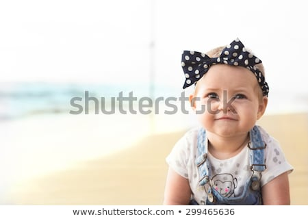 The little baby girl playing toys in sand Stock photo © master1305