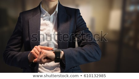 Mid section of woman using smart watch Stock photo © wavebreak_media