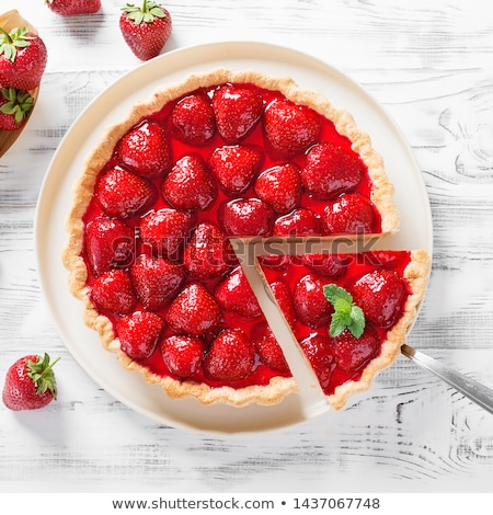 Stock photo: Delicious strawberry tart or cheesecake with fresh berries and cream cheese, closeup on white wooden