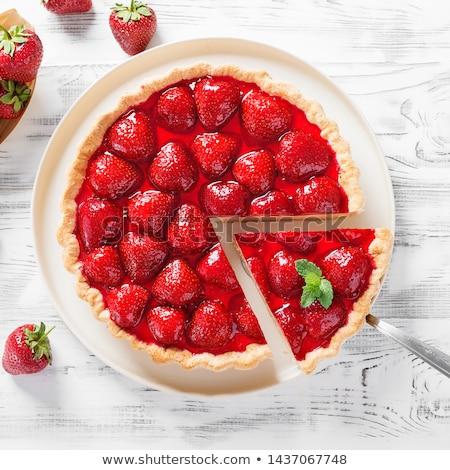 Delicious strawberry tart or cheesecake with fresh berries and cream cheese, closeup on white wooden Stock photo © yelenayemchuk