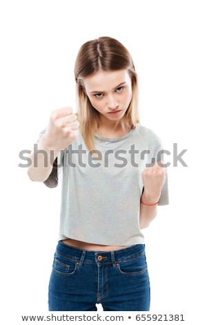 portrait of a serious aggresive woman showing two fists stock photo © deandrobot