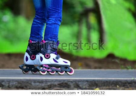 Anonymous woman roller skating in park Stock photo © dash