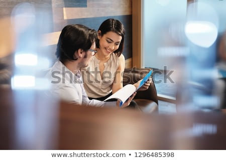 Businessman at bar reading paper, smile Stock photo © IS2