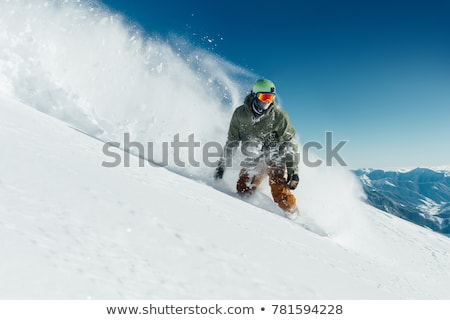 Snowboarder riding in deep snow Stock photo © IS2