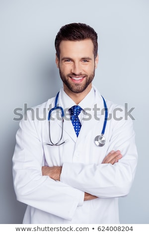 Portrait of a smiling handsome male doctor stock photo © deandrobot