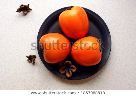 top view of three ripe persimmons on white Stock photo © LightFieldStudios