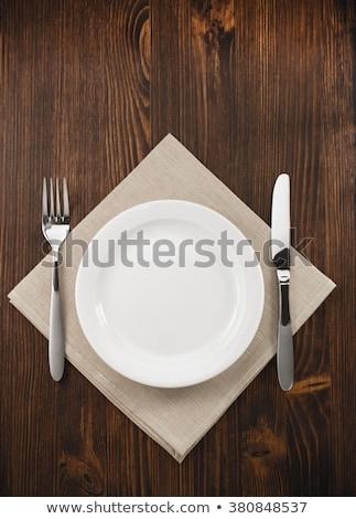Prato faca garfo servido mesa de madeira branco Foto stock © wavebreak_media