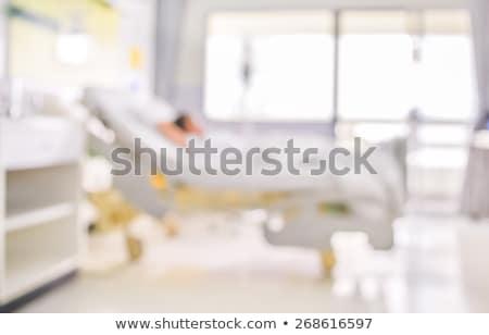 sad senior woman sitting on bed at hospital ward Stock photo © dolgachov