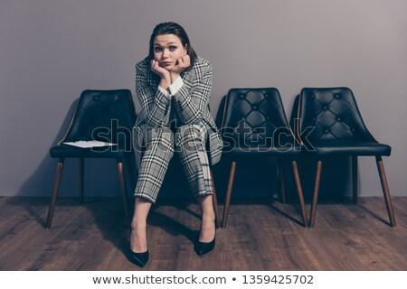 brunette businesswoman on high heels waiting in line Stock photo © feedough