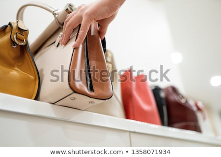 bags rows in retail shop handbags leather red Stock photo © lunamarina