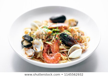 mixed seafood spaghetti pasta with prawns mussels scallops and c Stock photo © travelphotography