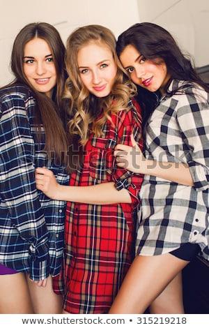 happy female friends at home pajama party Stock photo © dolgachov
