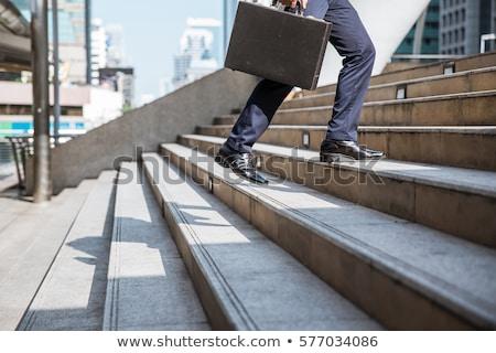 молодые · бизнесмен · ходьбе · вверх · лестницы - Сток-фото © dolgachov