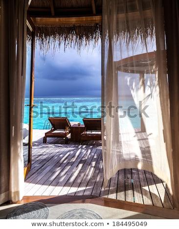 Iki ahşap bungalov su örnek manzara Stok fotoğraf © colematt