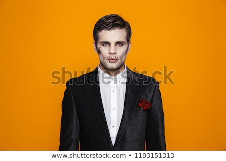 Photo of young zombie bridegroom wearing classical suit and hall Stock photo © deandrobot
