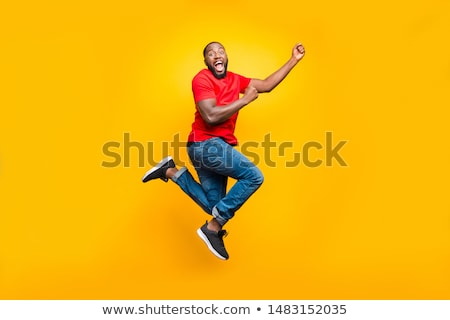 Full length photo of smiling african man having stylish afro hai Stock photo © deandrobot