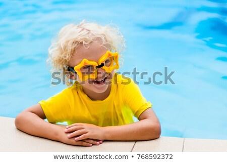 Loiro criança menina subaquático natação azul Foto stock © dashapetrenko