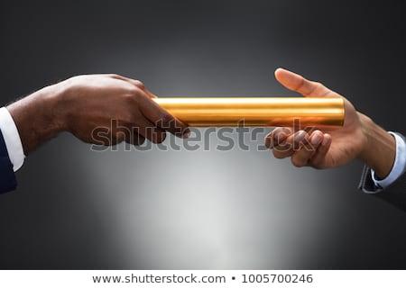 Businessman Passing Baton To His Partner Stock photo © AndreyPopov