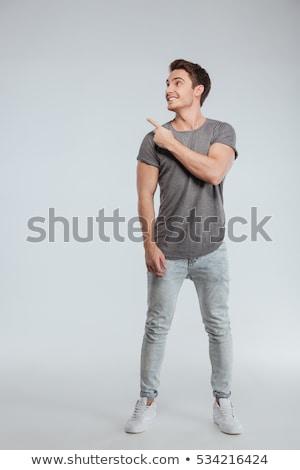 derűs · fiatalember · visel · kockás · póló · áll - stock fotó © deandrobot
