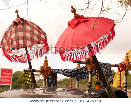 Balinese cloth umbrella. Umbrellas in Bali have a constructive, protective meaning Stock photo © galitskaya