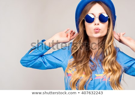 Cheerful young woman wearing sunglasses Stock photo © deandrobot