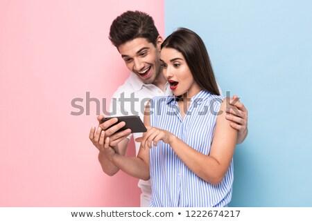 afbeelding · optimistisch · paar · mobiele · telefoons · samen · geïsoleerd - stockfoto © deandrobot