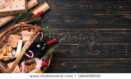 glass of red wine and food on christmas table stock photo © dolgachov