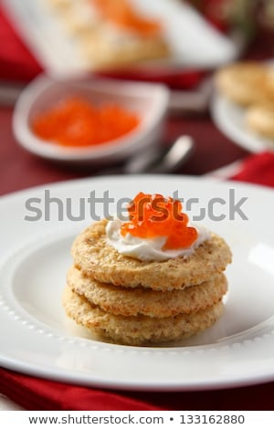 Oat bran cookies with red caviar and cream cheese Stock photo © Melnyk