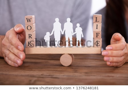 couple protecting work and life balance on seesaw stock photo © andreypopov