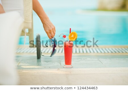woman lounging on swimming pool stock photo © kzenon