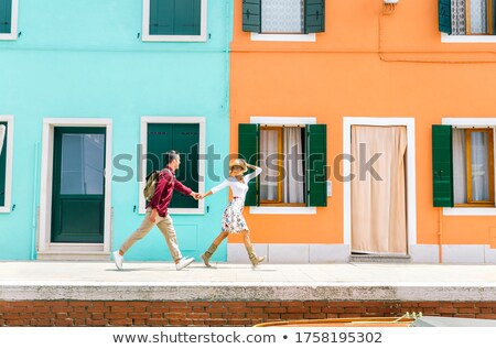 happy couple in front of houses at venice italy stock photo © andreypopov