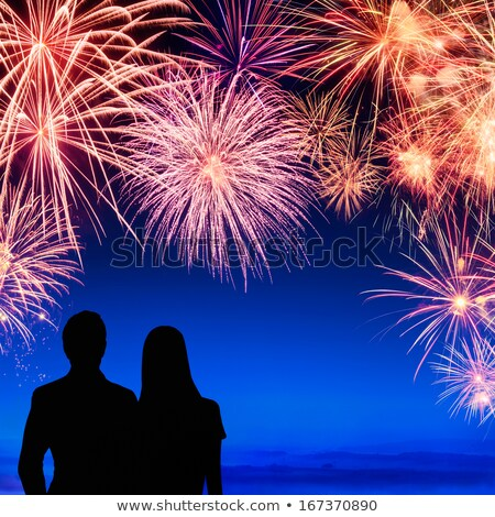 Young Couple Watching A Fireworks Display Stock photo © solarseven