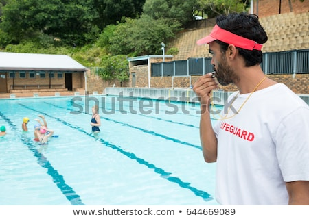 coach or lifeguard in the pool whistles Stock photo © studiostoks