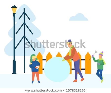 Father and Son Sculpting Snowman Outdoors Vector Stock photo © robuart