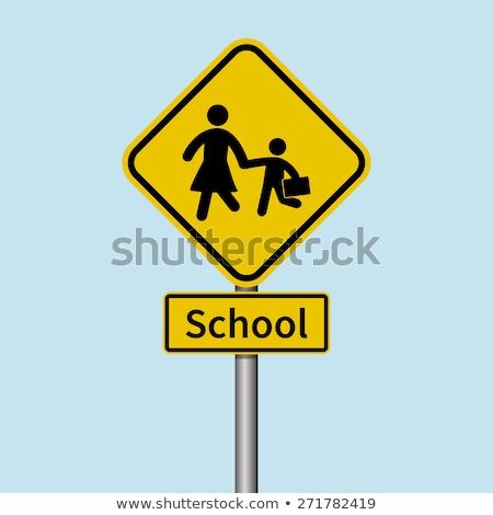 School crossing sign on metal pole Stock photo © bluering