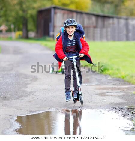 Boldog iskolások sisakok lovaglás mopedek oktatás Stock fotó © dolgachov
