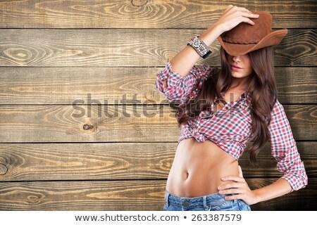 attractive cowboy girl in village Stock photo © fotoduki