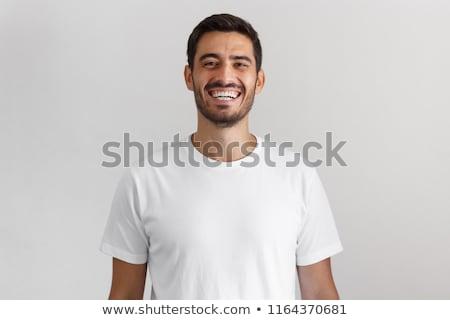 Derűs spanyol férfi mosolyog kamera izolált Stock fotó © Qingwa