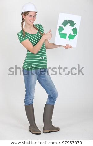 female apprentice holding recycling logo Stock photo © photography33